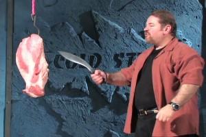 stabbing meat with a kukri machete