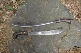Two condor parang machetes in the woods