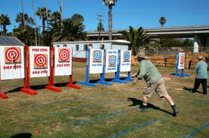 People throwing axes at a competition