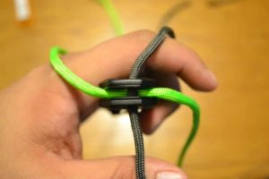 Threat the paracord threw the hold in your knife.