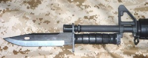 M9 BAYONET ATTACHED TO M16 RIFLE.